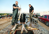 Josh Dunkle (cq) and Bubba Suggs (cq), with team ETH Bow Fishing, from Texas, choose their fish for their weigh in after the U.S. Open Bowfishing Championship, Sunday, May 4, 2014. <br /> <br /> Photo by Matt Nager