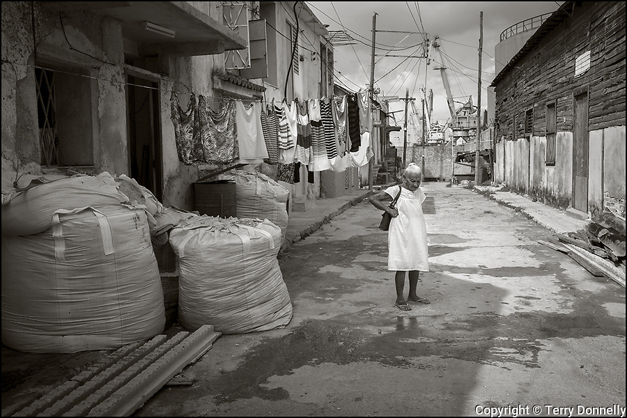 Regla, Havana, Cuba:<br /> Street scene with elderly woman in white,  in the Regla nieghborhood