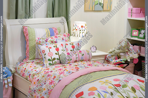 Nice children bedroom furniture in pastel shades Child room interior Bed with colorful linen