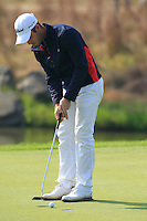 Romain Wattel (FRA) putts on the 8th green during Sunday's Final Round of the 2014 BMW Masters held at Lake Malaren, Shanghai, China. 2nd November 2014.<br /> Picture: Eoin Clarke www.golffile.ie