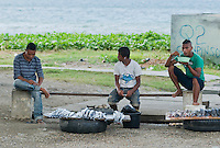 Fishermen offer the day's catch for sale in Dili, Timor-Leste (East Timor)