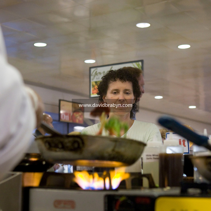 Employees wait for their food at the cafeteria at the Pitney Bowes headquarters in Stamford, CT, United States, 7 October 2008.