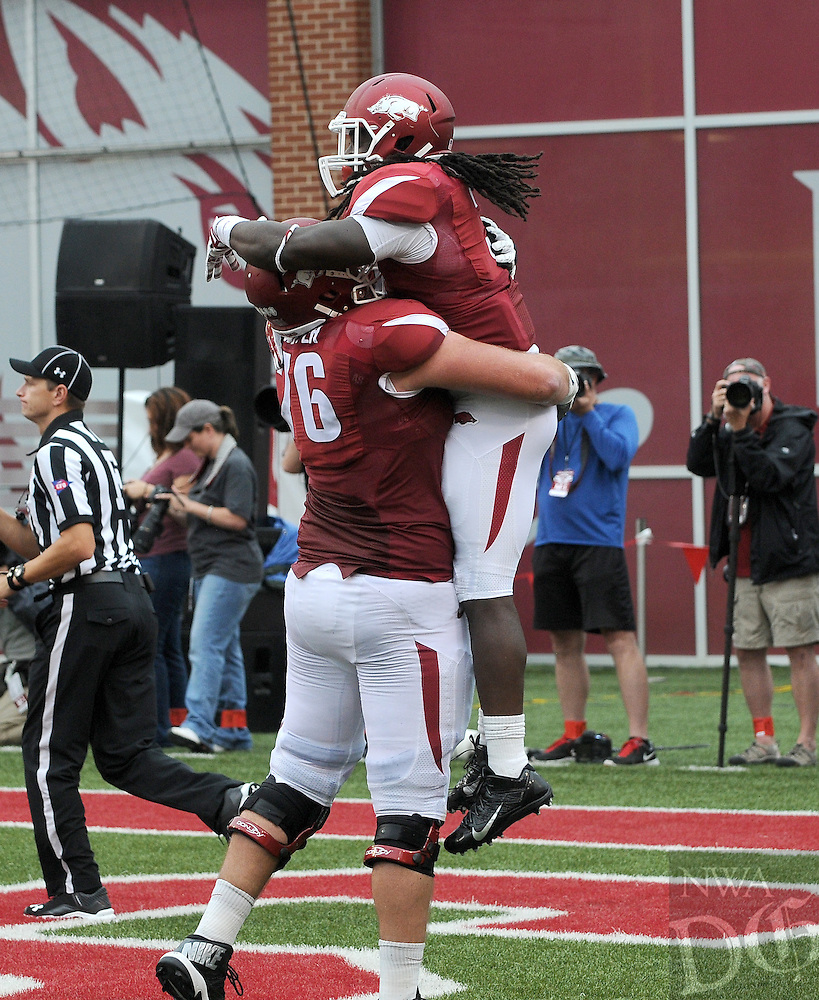 STAFF PHOTO ANTHONY REYES • @NWATONYR<br /> Dan Skipper Razorbacks offensive tackles celebrates a touchdown with Alex Collins against Nicholls State in the second quarter Saturday, Sept. 6, 2014 at Razorback Stadium in Fayetteville.