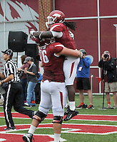 STAFF PHOTO ANTHONY REYES &bull; @NWATONYR<br /> Dan Skipper Razorbacks offensive tackles celebrates a touchdown with Alex Collins against Nicholls State in the second quarter Saturday, Sept. 6, 2014 at Razorback Stadium in Fayetteville.