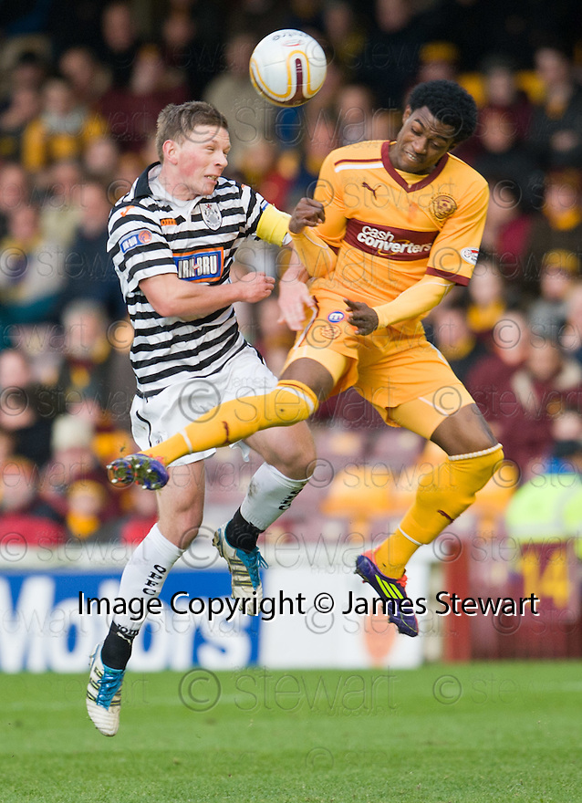 RICHARD LITTLE CHALLENGES MOTHERWELL'S OMAR DALEY IN THE AIR ..07/01/2012 sct_jsp021_motherwell_v_queens_park     .Copyright  Pic : James Stewart.James Stewart Photography 19 Carronlea Drive, Falkirk. FK2 8DN      Vat Reg No. 607 6932 25.Telephone      : +44 (0)1324 570291 .Mobile              : +44 (0)7721 416997.E-mail  :  jim@jspa.co.uk.If you require further information then contact Jim Stewart on any of the numbers above.........