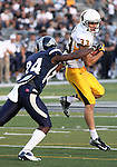 Wyoming's Dominic Rufran (33) tries to to break a tackle from Nevada's Charles Garrett (24) during the first half of an NCAA college football game in Reno, Nev., on Saturday, Oct. 6, 2012. (AP Photo/Cathleen Allison)