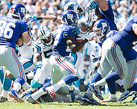 The Carolina Panthers played the New York Giants at Bank of America Stadium in Charlotte, NC.  The Panthers won 38-0 for their first victory of the season.  The Giants dropped to 0-3.  New York Giants running back David Wilson (22) is tackled by Carolina Panthers outside linebacker Thomas Davis (58)