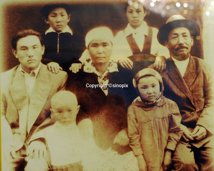 A picture of  Nursultan Nazaarbayev, (left) with his family as seen in the museum dedicated to Nazaarbayev in Astana, the capitol of Kazakstan.<br /> <br /> PHOTO BY RICHARD JONES/SINOPIX