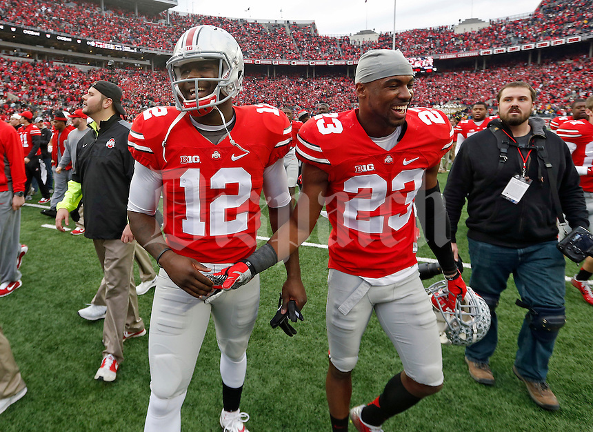 Ohio State Buckeyes safety Tyvis Powell (23) and Ohio State Buckeyes quarterback Cardale Jones (12) celebrate their win over Michigan Wolverines at Ohio Stadium in Columbus, Ohio on November 29, 2014.  (Dispatch photo by Kyle Robertson)