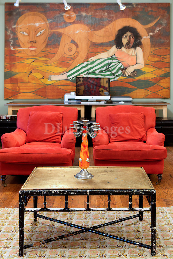 Red armchairs and wall art