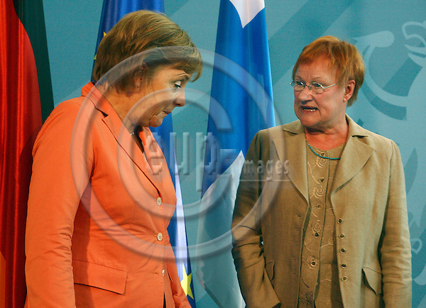 HELSINGIN SANOMAT HSPO -- BERLIN - GERMANY 20.  JUNE 2006 -- Finnish President Mrs. Tarja HALONEN on official visit to Germany, in the picture she speaking with German Chancellor Angela MERKEL. during a joint statement to the press-- PHOTO: UFFE NARD / EUP-IMAGES