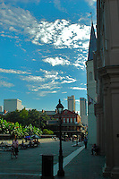City streets of New Orleans blue heaven skies, the sound of music on every street corner, and the unique architecture that stands apart of unique history of United States.