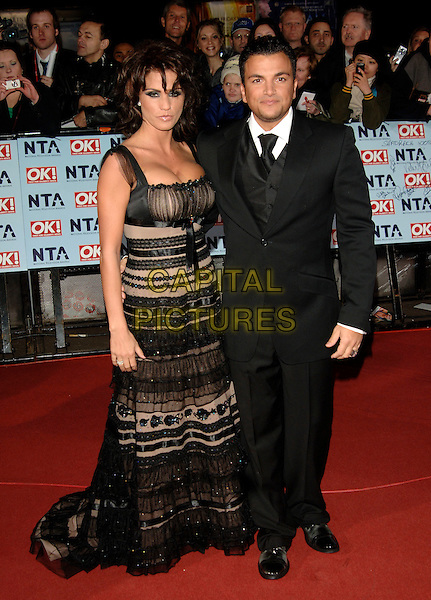 JORDAN - KATIE PRICE & PETER ANDRE.The National Television Awards 2006 held at the Royal Albert Hall, London, UK. - Arrivals.October 31st, 2006.Ref: PL.full length black sheer dress stripes striped suit married couple husband.www.capitalpictures.com.sales@capitalpictures.com.©Phil Loftus/Capital Pictures