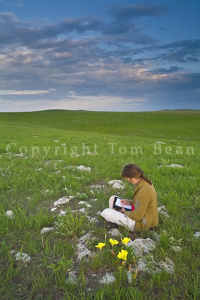 Writer, Susan Lamb, taking notes while visiting Tallgrass Prairie National Preserve in the Flint Hills near Strong City, Kansas, AGPix_0606