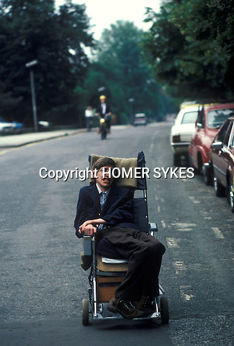 Professor Stephen Hawking Cambridege University using his wheel chair to get to college. Cambridge UK 1981. 1980'S.