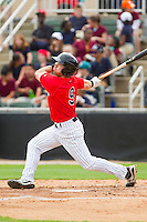 Kale Kiser (9) of the Kannapolis Intimidators follows through on his swing against the Delmarva Shorebirds at CMC-Northeast Stadium on April 17, 2013 in Kannapolis, North Carolina.  The Shorebirds defeated the Intimidators 9-4.  (Brian Westerholt/Four Seam Images)