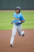 Gleyber Torres (11) of the Myrtle Beach Pelicans rounds the bases after hitting a solo home run in the top of the first inning against the Winston-Salem Dash at BB&T Ballpark on April 19, 2016 in Winston-Salem, North Carolina.  The Dash defeated the Pelicans 6-5.  (Brian Westerholt/Four Seam Images)
