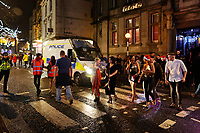 People out in Wind Street, Swansea, Wales  on Mad Friday, Booze Black Friday or Black Eye Friday, the last Friday night before Christmas Day, when traditionally people in the UK go out to celebrate the start of their holidays. Friday 22 December 2017