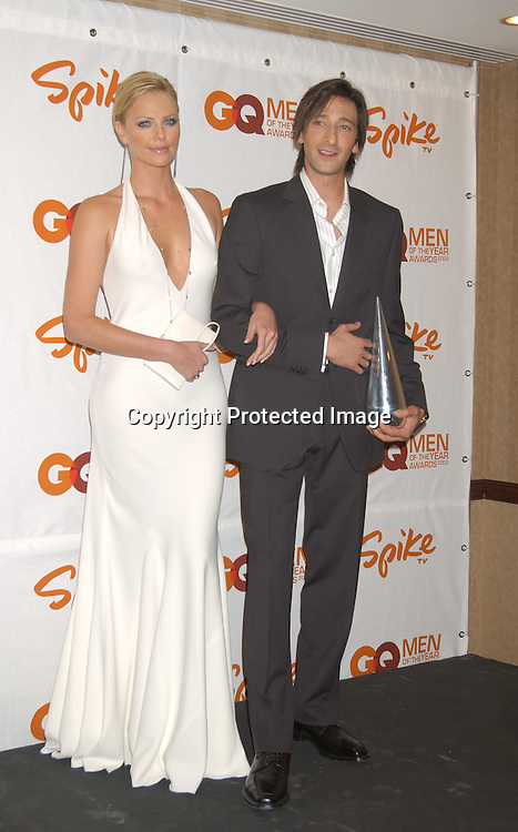 """Adrien Brody and Charlize Theron                                ..at the Eighth Annual GQ """" Men of the Year """" Awards on ..Spike TV on October 21, 2003 at the Regent Wall Street  ..in New York City. Photo by Robin Platzer, Twin Images"""