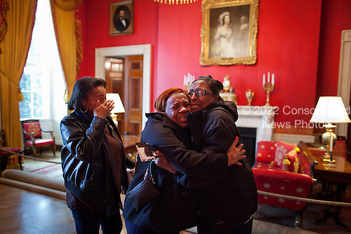 Women react in the Red Room after meeting First Lady Michelle Obama during their White House tour, February 16, 2012. .Mandatory Credit: Chuck Kennedy - White House via CNP