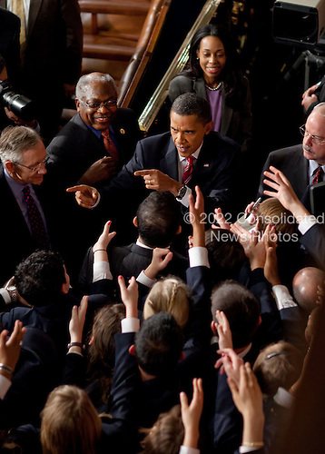 UNited States House pages reach to shake hands with U.S. President Barack Obama as he leaves the House Chamber at the conclusion of his State of the Union address, Wednesday, January 27, 2010..Mandatory Credit: Chuck Kennedy - White House via CNP
