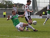 Leis Stevenson tackles Paul McGowan in the St Mirren v Hibernian Clydesdale Bank Scottish Premier League match played at St Mirren Park, Paisley on 29.4.12.
