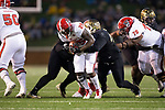 Reggie Gallaspy II (25) of the North Carolina State Wolfpack is tackled by Willie Yarbary (48) of the Wake Forest Demon Deacons during second half action at BB&T Field on November 18, 2017 in Winston-Salem, North Carolina.  The Demon Deacons defeated the Wolfpack 30-24.  (Brian Westerholt/Sports On Film)