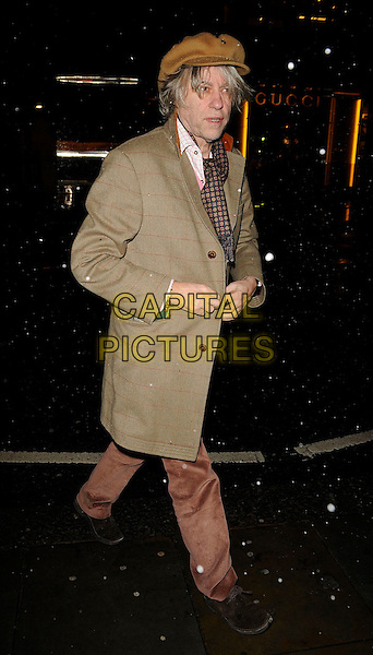 SIR BOB GELDOF .Roger Vivier Champagne et Chocolat Party, Roger Vivier Boutique, Sloane Street, London, England, .February 12th 2209..full length brown hat cap tan jacket coat scarf trousers check checked old fashioned  clothes shoes .CAP/CAN.©Can Nguyen/Capital Pictures