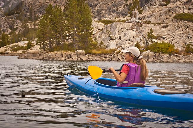 Woman kayaking on Lake Faucherie, Northern California.