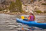 Woman kayaking on Lake Faucherie, Northern California.