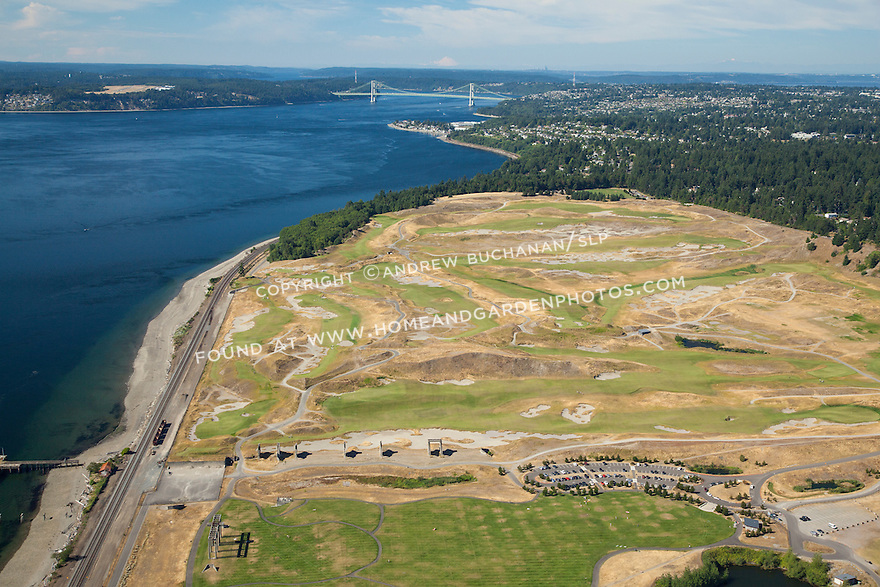 aerial view of Chambers Bay Golf Course looking northwest with Puget Sound and the Tacoma Narrows Bridge behind, site of the 2015 US Open Championship; University Place, WA near Tacoma