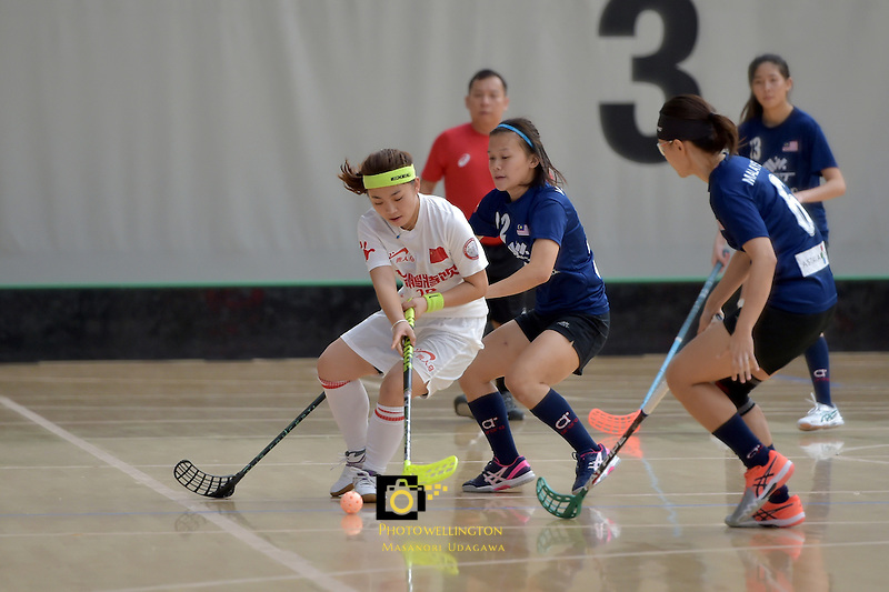China's Yingying Chen and Malaysia's Ling Ling Ang in action during the World Floorball Championships 2017 Qualification for Asia Oceania Region - Malaysia v China at ASB Sports Centre , Wellington, New Zealand on Sunday 5 February 2017.<br /> Photo by Masanori Udagawa<br /> www.photowellington.photoshelter.com.