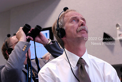 "NASA Associate Administrator for Space Operations, Bill Gerstenmaier (foreground) watches the launch of the Space Shuttle Endeavour (STS-118) from the Launch Control Center Wednesday, August 8, 2007, at the Kennedy Space Center in Cape Canaveral, Fla. The Shuttle lifted off from launch pad 39A at 6:36p.m. EDT. Photo Credit: ""NASA/Bill Ingalls"""