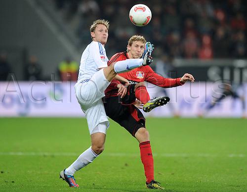 17.11.2012. Leverkusen, Germany.  Bayer 04 Leverkusen versus FC Schalke 04 Benedict Howedes Schalke 04 left against Stefan KieBling Bayer 04 Leverkusen