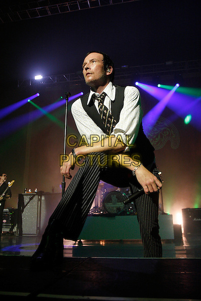 STONE TEMPLE PILOTS - SCOTT WEILAND .Performing live at the Brixton Academy, London, England..June 16th, 2010.stage concert live gig performance music full length black shirt pinstripe white shirt waistcoat grey gray leaning bending .CAP/MAR.© Martin Harris/Capital Pictures.