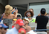 FLUSHING NY- SEPTEMBER 2: Redfoo of the Group LMFAO lets fans take his photo during Novak Jokovic Vs Julien Benneteau on Arthur Ashe stadium at the USTA Billie Jean King National Tennis Center on September 2, 2012 in in Flushing Queens. Credit: mpi04/MediaPunch Inc. ***NO NY NEWSPAPERS*** /NortePhoto.com<br />