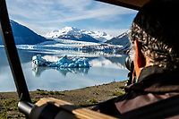Photographer man takes aerial photo from open-door helicopter of ice berg and Colony Glacier at Inner Lake George. Summer. Southcentral, Alaska.   People/person<br /> <br /> (C) Jeff Schultz/SchultzPhoto.com