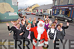 Santa who will be leading the Christmas Parade in Listowel with the staff of Pierse and Fitzgibbons in Listowel