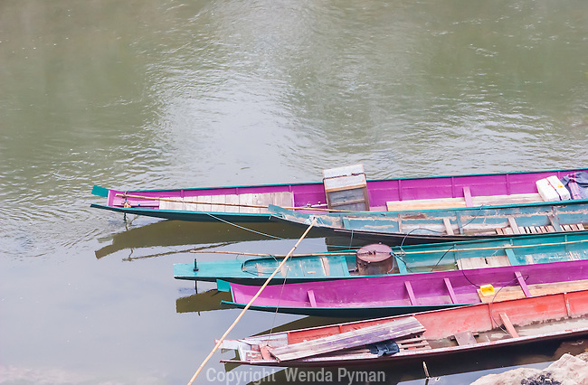 Colorful long boats along the Nam Khan.