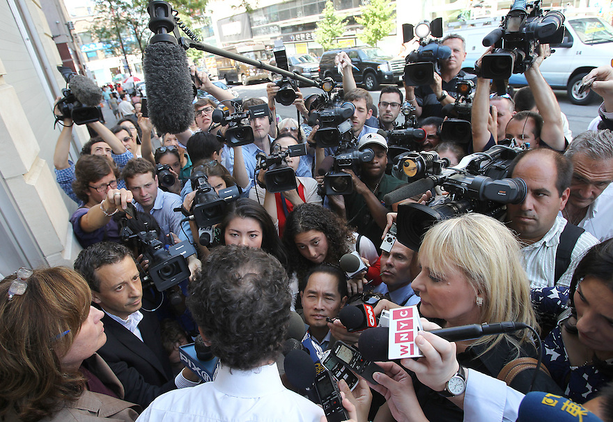 Anthony Weiner speaks to the media after making a stop at the Nah Shan Senior Center on Monday, July 29, 2013 in Staten Island, New York. (AP Photo/ Donald Traill)