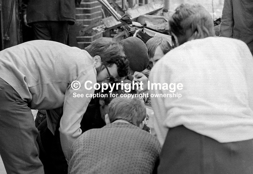 Woman is treated at the scene of Provisional IRA no warning car bomb explosion in Lower Donegall Street, Belfast, in which seven people died and 130 were injured. Four of the dead were binmen. NI Troubles. Ref: 19720320008...Copyright Image from Victor Patterson, 54 Dorchester Park, Belfast, UK, BT9 6RJ..Tel: +44 28 9066 1296.Mob: +44 7802 353836.Voicemail +44 20 8816 7153.Skype: victorpattersonbelfast.Email: victorpatterson@mac.com.Email: victorpatterson@ireland.com (back-up)..IMPORTANT: If you wish to use this image or any other of my images please go to www.victorpatterson.com and click on the Terms & Conditions. Then contact me by email or phone with the reference number(s) of the image(s) concerned.