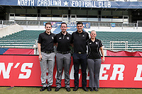 Cary, North Carolina  - Saturday August 19, 2017: Match officials Tom Felice, Ryan Graves, Elvis Osmanovic, and Maggie Short prior to a regular season National Women's Soccer League (NWSL) match between the North Carolina Courage and the Washington Spirit at Sahlen's Stadium at WakeMed Soccer Park. North Carolina won the game 2-0.