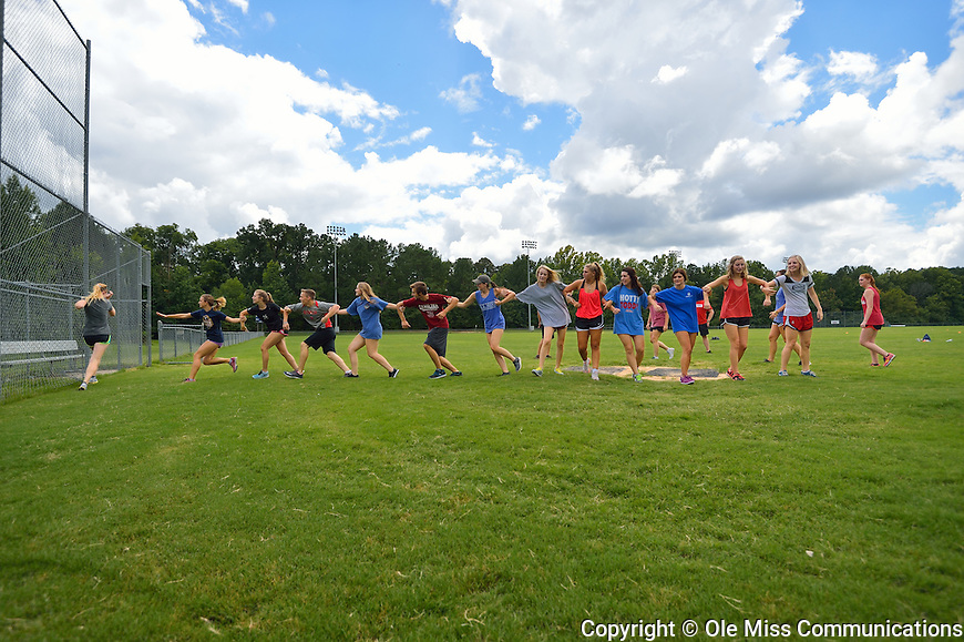 Honors College freshmen get to know one another as they play a game of 'blob tag' at the intramural fields during an Honors College Welcome Week event. Photo by Robert Jordan/Ole Miss Communications