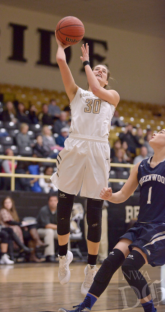 NWA Democrat-Gazette/BEN GOFF @NWABENGOFF<br /> Madison Brittain of Bentonville makes a shot over Kyiah Julian of Greenwood on Thursday Dec. 17, 2015 during the game in Bentonville's Tiger Arena.