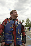 Garden City, New York, U.S. - June 14, 2014 - ANDREW DIONNE, of Bowie MD, is a USA Knights member wearing warrior combat sport armor at Eternal Con, the annual Pop Culture Expo, with costumes, Comic Books, Collectibles, Gaming, Sci-Fi, Cosplay, Horror, and held at the Cradle of Aviation Museum on Long Island. Armored Combat League members compete in international medieval combat competitions.