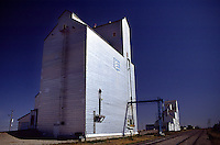 Wheat grain Silo by rail tracks, prairie of Saskatchewan..