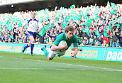 25.02.2012 Dublin, Ireland. Rugby Union. Ireland v Italy. Andrew Trimble (Ireland) dives over to score the final try of the game during the Six Nations game played at the Aviva Stadium in Dublin.