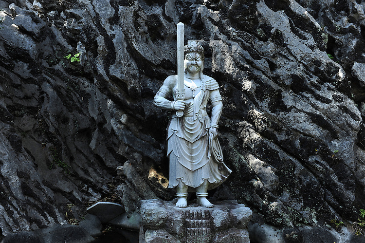 A sculpture of Fudo-Myo-O, an incarnation of Buddha, who is a protective deity of Japanese Buddhism, at a temple on the Henro Rout or Ohenro Path. Shikoku. Japan.