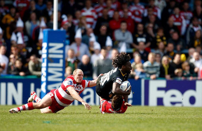 Photo: Richard Lane/Richard Lane Photography. London Wasps v Gloucester Rugby. Amlin Challenge Cup Quarter Final. 11/04/2010. Wasps' Paul Sackey is tackled by  Gloucester's Mike Tindall and Jonny May.