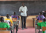 De La Salle Brother Joseph Alak, the school's director, teaches a class of boys in the De La Salle Brothers Secondary School, temporarily located in the Loreto School in Rumbek, South Sudan.